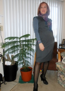 Gray turtleneck: Old Navy. Gray and black shift dress: Target. Purple scarf: Wal-Mart. Purple and silver bracelet: gift from dad. Black tights: unknown. Gray and black shoes: Payless.