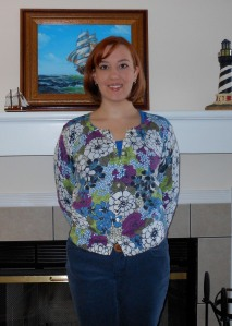 Flowered cardigan: Old Navy. Blue scoopneck t-shirt (underneath): Old Navy. Blue courderoys: Old Navy. Brown belt: (thrifted.)